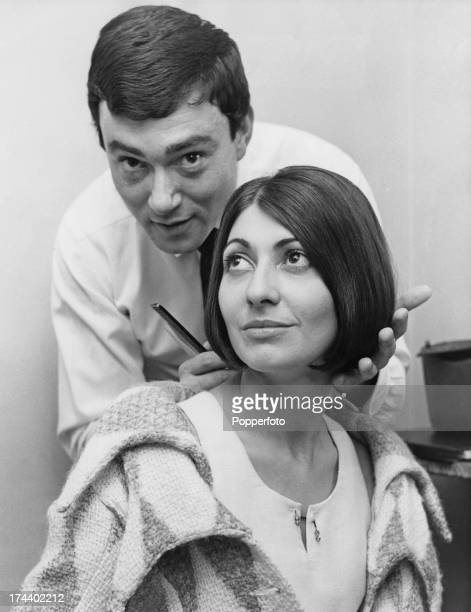 British hairdresser Vidal Sassoon styles the hair of French fashion designer Emmanuelle Khanh at his salon in Old Bond Street London 12th September...