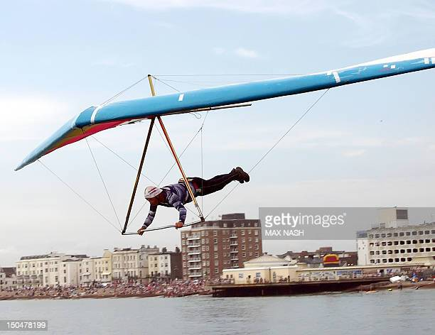 British hang glider Ron Freeman takes his Condor over the sea during the annual Birdman Competition in Worthing West Sussex on August 19 2012 The...