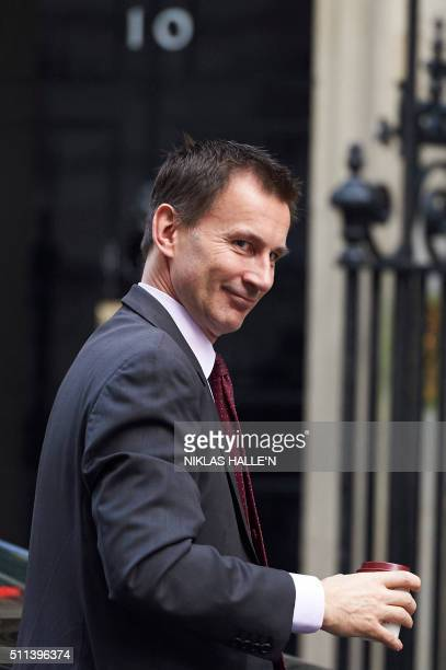 British Health Secretary Jeremy Hunt arrives at Downing Street in London on February 20 2016 for a meeting of the cabinet following Prime Minister...