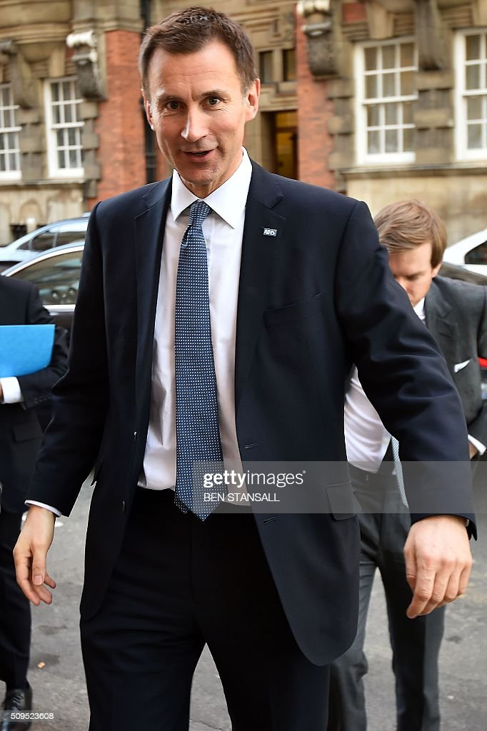 British Health Secretary Jeremy Hunt arrives at Millbank studios in central London on February 11, 2016. Britain's government said February 11 it would impose new contracts on junior doctors to force an end to strikes over changes to their working conditions. Health Secretary Jeremy Hunt told the House of Commons that the decision had been taken after negotiations with doctors' union the British Medical Association (BMA) failed. STANSALL