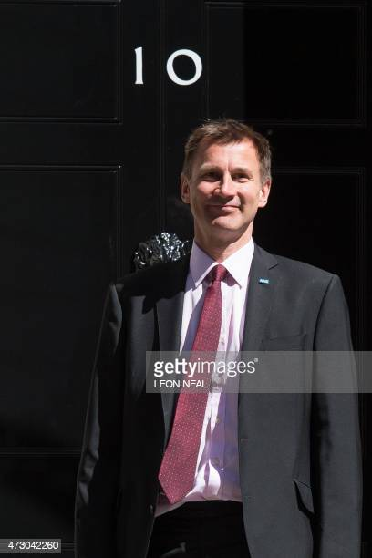British Health Secretary Jeremy Hunt arrives for the first weekly cabinet meeting in Downing Street central London on May 12 following the May 7...