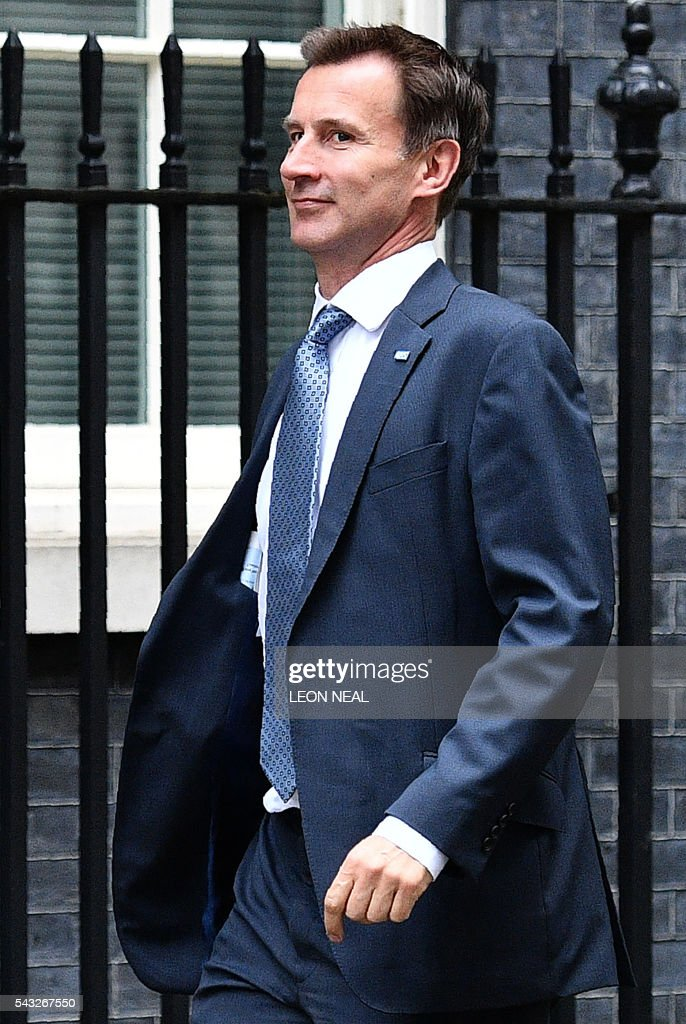 British Health Secretary Jeremy Hunt arrives to attend a cabinet meeting at 10 Downing Street in central London on June 27, 2016. European stock markets mostly slid Monday as British finance minister George Osborne attempted to calm jitters after last week's shock Brexit referendum. Britain's surprise referendum decision to leave the European Union wiped $2.1 trillion off market valuations on Friday and sent the pound collapsing to a 31-year low against the dollar. / AFP / LEON