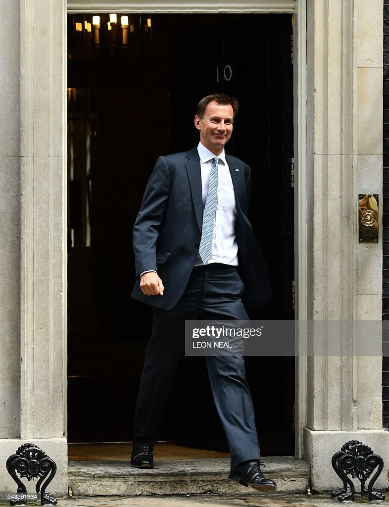 British Health Secretary Jeremy Hunt walks through the door of 10 Downing Street after attending a cabinet meeting in central London on June 27, 2016. European stock markets mostly slid Monday as British finance minister George Osborne attempted to calm jitters after last week's shock Brexit referendum. Britain's surprise referendum decision to leave the European Union wiped $2.1 trillion off market valuations on Friday and sent the pound collapsing to a 31-year low against the dollar. / AFP / LEON