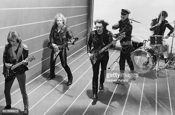 British heavy metal band Judas Priest during the video shoot for their single 'Don't Go' January 1981 Left to right Glenn Tipton K K Downing Ian Hill...