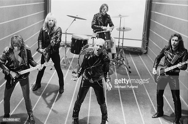 British heavy metal band Judas Priest during the video shoot for their single 'Don't Go' January 1981 Left to right Glenn Tipton K K Downing Rob...