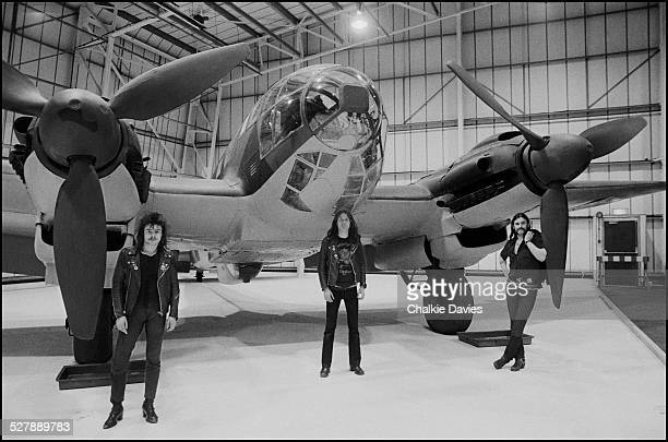 British heavy metal group Motorhead pose next to a Heinkel He 111 bomber at the Imperial War Museum in London 1979 Left to right drummer Phil...