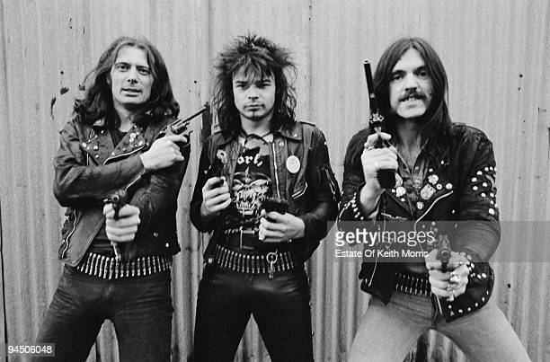 British heavy rock band Motorhead pose with pistols London 1978 Left to right guitarist 'Fast' Eddie Clarke drummer Phil 'Philthy Animal' Taylor and...