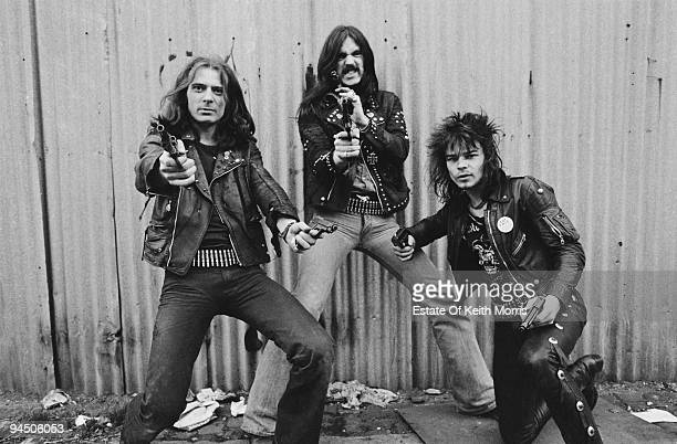 British heavy rock band Motorhead pose with pistols London 1978 Left to right guitarist 'Fast' Eddie Clarke bassist and singer Lemmy and drummer Phil...