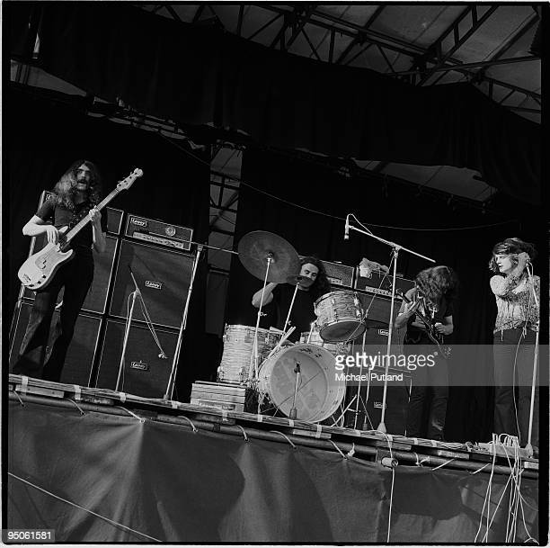British heavy rock group Black Sabbath performing at the Plumpton festival in Sussex 8th August 1970 Left to right bassist Geezer Butler drummer Bill...