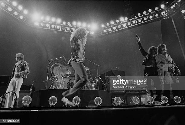 British heavy rock group Led Zeppelin leaving the stage during a concert at at Earl's Court London May 1975 Left to right bassist John Paul Jones...