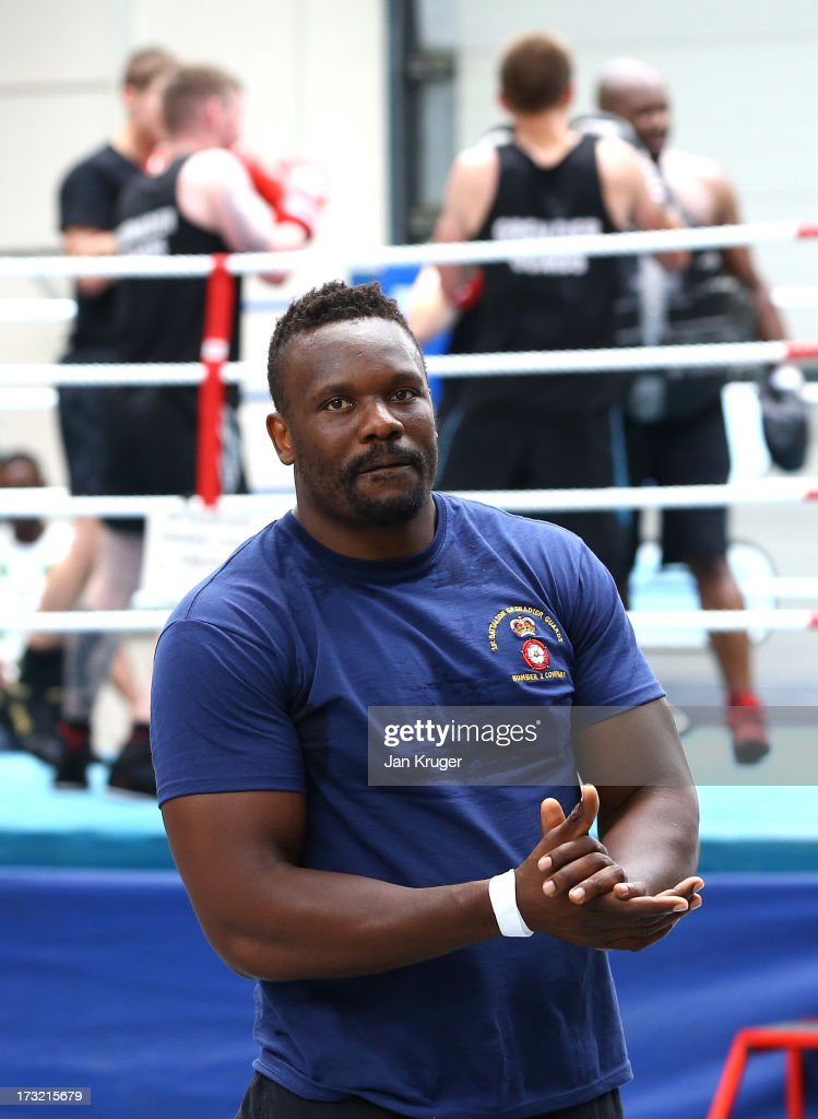 British heavyweight boxer Dereck Chisora looks on during a media workout with Army boxers from the Grenadier Guards as he prepares for his showdown with undefeated Malik Scott of the USA at Lille Barracks on July 10, 2013 in Aldershot, England.
