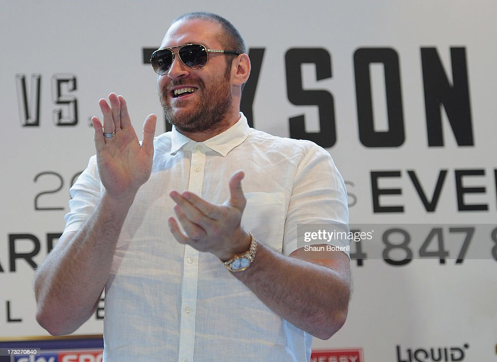 British heavyweight boxer <a gi-track='captionPersonalityLinkClicked' href=/galleries/search?phrase=Tyson+Fury&family=editorial&specificpeople=5739191 ng-click='$event.stopPropagation()'>Tyson Fury</a> welcomes David Haye (not pictured) to a press conference to announce their upcoming title fight on July 11, 2013 in London, England.