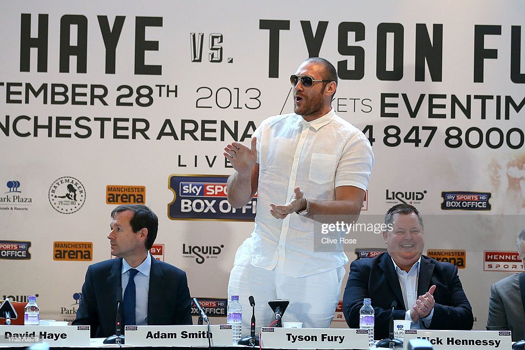 British heavyweight boxer <a gi-track='captionPersonalityLinkClicked' href=/galleries/search?phrase=Tyson+Fury&family=editorial&specificpeople=5739191 ng-click='$event.stopPropagation()'>Tyson Fury</a> (C) welcomes David Haye (not pictured) to the press conference to announce their upcoming title fight on July 11, 2013 in London, England.