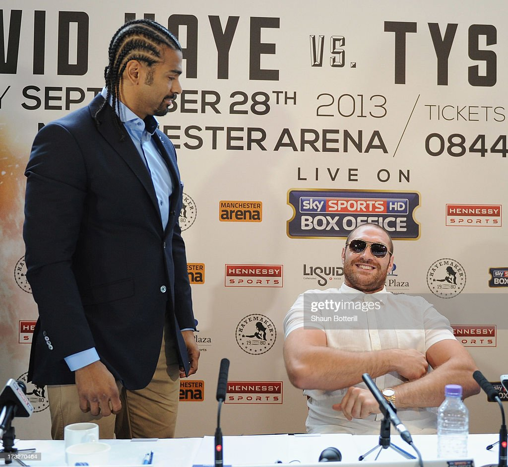 British heavyweight boxers David Haye (L) and Tyson Fury attend a press conference to announce their upcoming title fight on July 11, 2013 in London, England.
