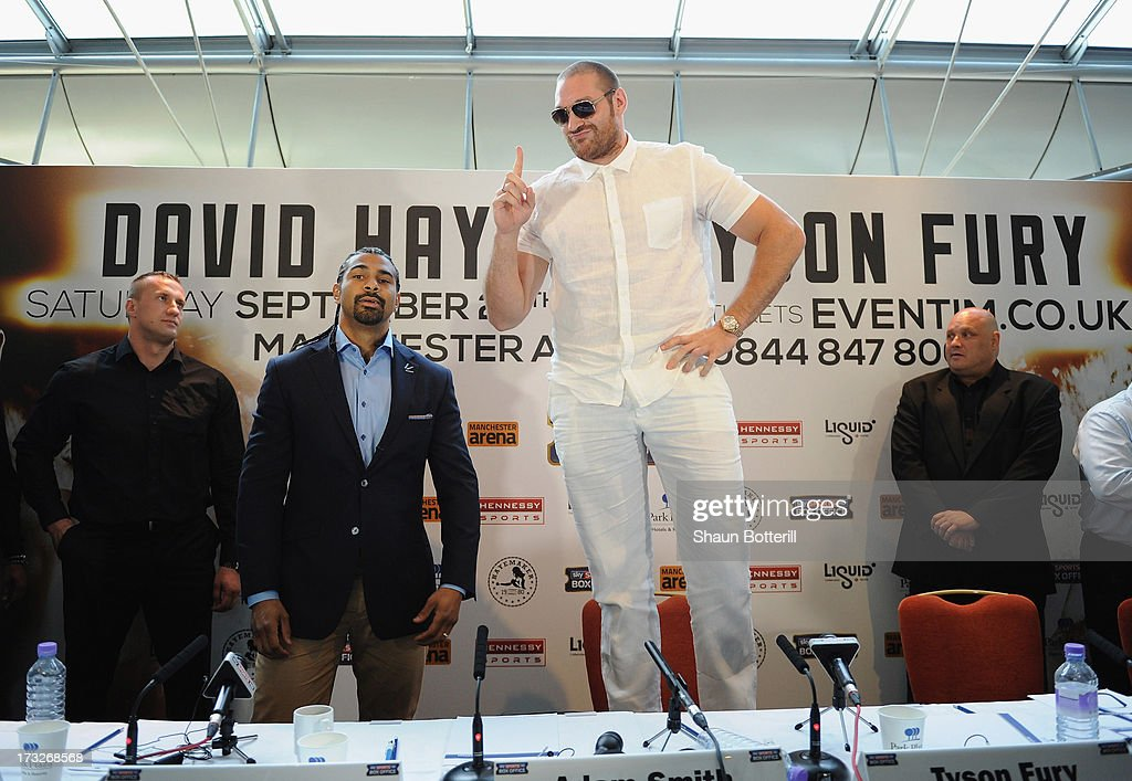 British heavyweight boxers <a gi-track='captionPersonalityLinkClicked' href=/galleries/search?phrase=Tyson+Fury&family=editorial&specificpeople=5739191 ng-click='$event.stopPropagation()'>Tyson Fury</a> (C) and <a gi-track='captionPersonalityLinkClicked' href=/galleries/search?phrase=David+Haye&family=editorial&specificpeople=220778 ng-click='$event.stopPropagation()'>David Haye</a> (2nd L) attend a press conference to announce their upcoming title fight, on July 11, 2013 in London, England.