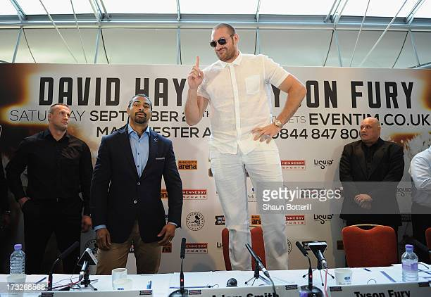 British heavyweight boxers Tyson Fury and David Haye attend a press conference to announce their upcoming title fight on July 11 2013 in London...