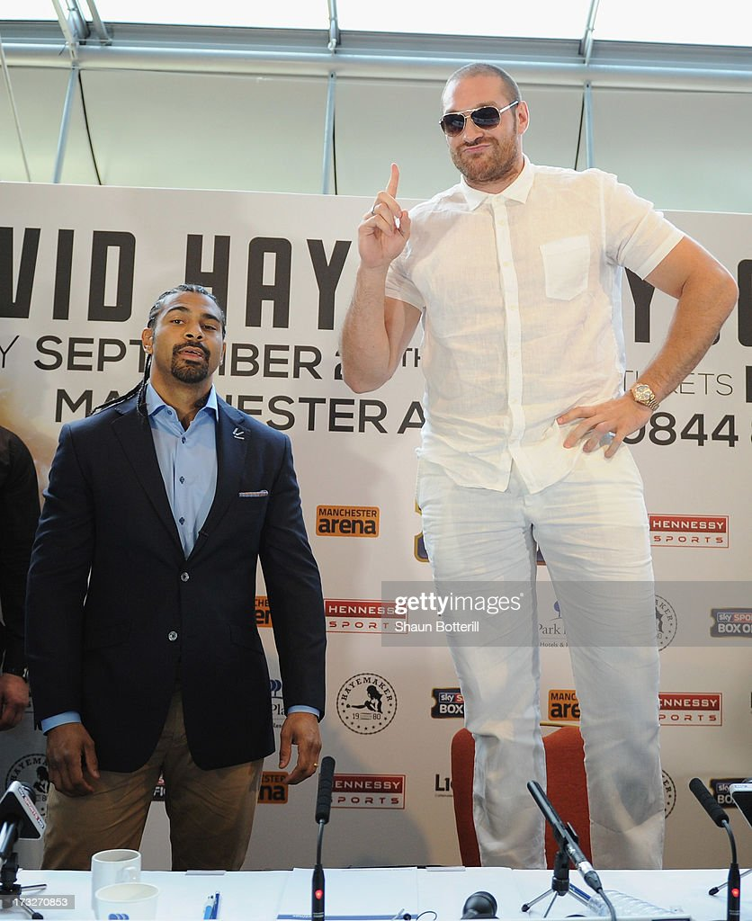 British heavyweight boxers Tyson Fury (R) and David Haye attend a press conference to announce their upcoming title fight on July 11, 2013 in London, England.