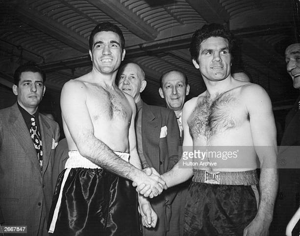 British heavyweight boxing champion Freddie Mills shaking hands with his opponent Joe Maxim