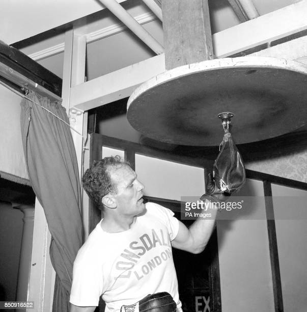 British heavyweight champion Henry Cooper during training at Bellingham in Kent after he burst a speed ball with a powerful left hook He is preparing...