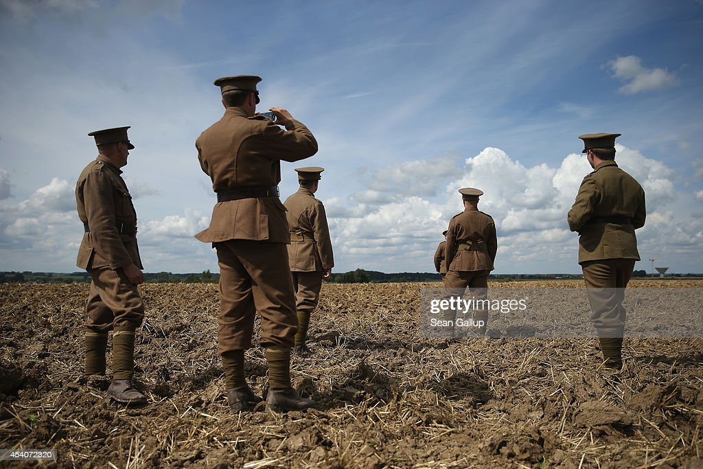 British historical society members dressed as soldiers of the World War I British Cheshire Regiment walk on the battlefield site following the inauguration ceremony of a monument to honour members of the British Cheshire Regiment and other soldiers who died fighting the German Army exactly 100 years before during World War I on August 24, 2014 in Audregnies, Belgium. Of the 25 officers and 925 men of the 1st Battalion, Cheshire Regiment who fought that day on August 24, 1914, only a total of 207 would survive after two messengers with instructions for the unit to retreat failed to make it through. The battle came on the heals of the Battle of Mons the day before, which was the first major engagmement between British and German forces in the war. The British, French and Belgian armies were forced to continue their retreat until weeks later, when only a short distance from Paris they managed to reverse the tide of the war and push the Germans back north.