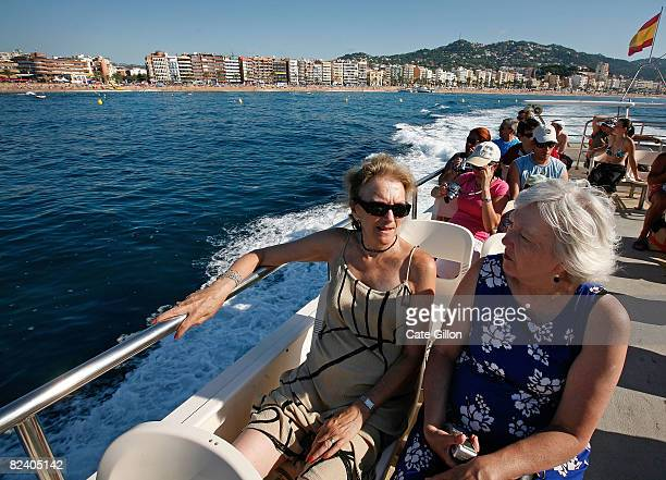 British holidaymakers leave Lloret beach for a day trip on a tour boat on August 18 2008 in Lloret de Mar Spain Feeling the pinch from the credit...