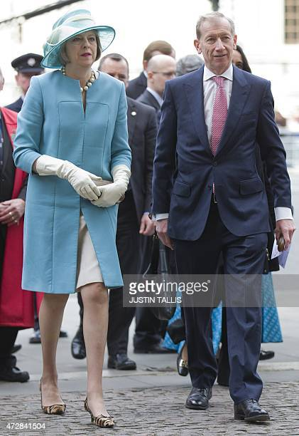 British Home Secretary Theresa May and her husband Philip arrive to attend a service of national thanksgiving to mark the 70th anniversary of VE Day...