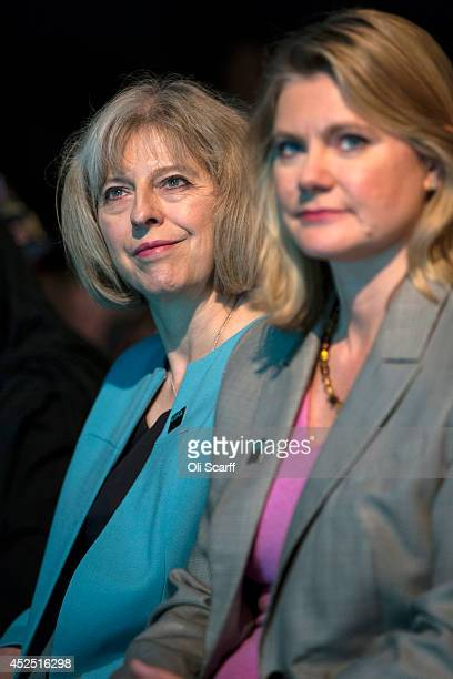 British Home Secretary Theresa May and Justine Greening the Secretary of State for International Development listen to the speeches at the 'Girl...