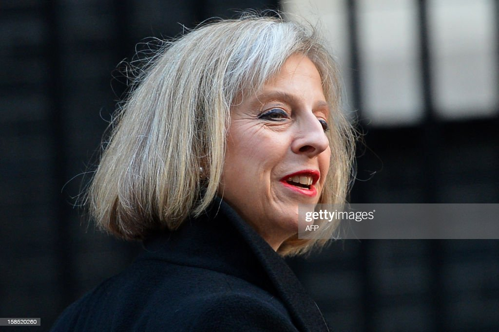 British Home Secretary Theresa May arrives in Downing Street to attend the Cabinet meeting in central London on December 18, 2012. Britain's Queen Elizabeth II attended her first-ever cabinet meeting to mark her diamond jubilee.