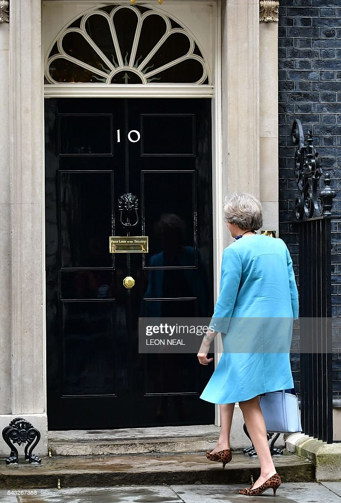 British Home Secretary Theresa May arrives to attend a cabinet meeting at 10 Downing Street in central London on June 27, 2016. European stock markets mostly slid Monday as British finance minister George Osborne attempted to calm jitters after last week's shock Brexit referendum. Britain's surprise referendum decision to leave the European Union wiped $2.1 trillion off market valuations on Friday and sent the pound collapsing to a 31-year low against the dollar. / AFP / LEON