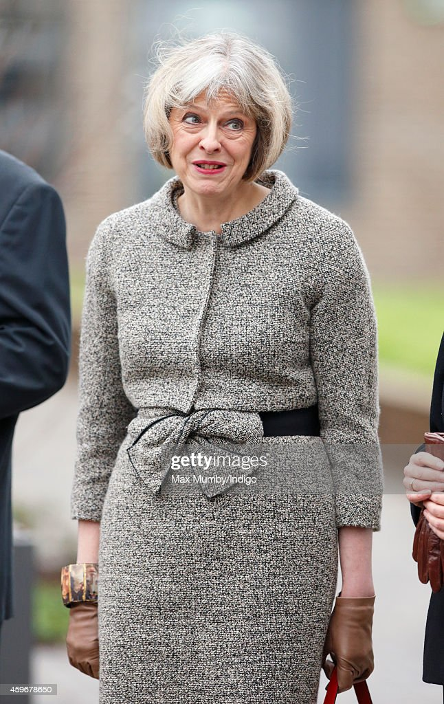 British Home Secretary Theresa May awaits the arrival Queen Elizabeth II for a visit to Holyport College on November 28, 2014 in Holyport, England.