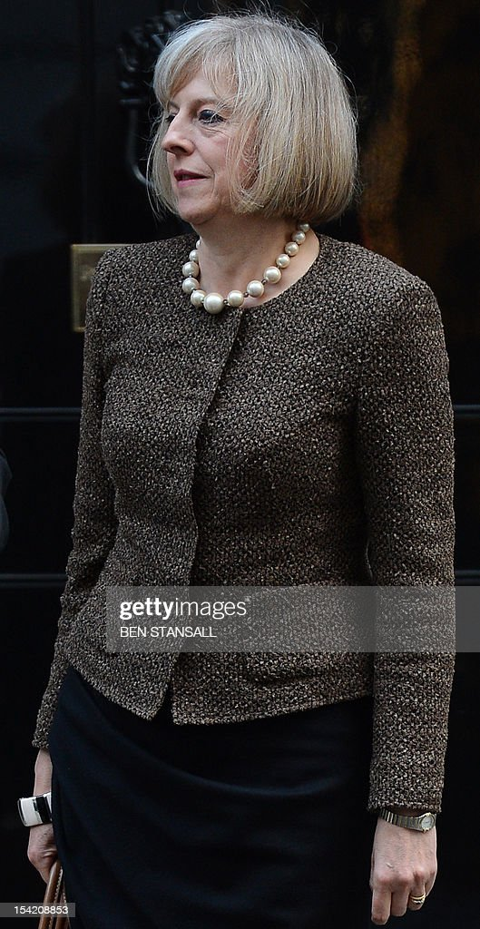British Home Secretary Theresa May leaves 10 Downing street in central London on October 16, 2012. British hacker Gary McKinnon, an Asperger's sufferer who broke into US military computers, will not be extradited to the US following a ten-year legal fight, interior minister Theresa May said October 16.