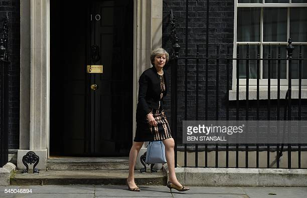 British Home Secretary Theresa May leaves after attending a cabinet meeting at 10 Downing Street in central London on July 5 2016 In a move that sent...