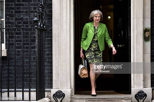 British Home Secretary Theresa May leaves after the first weekly cabinet meeting in Downing Street on May 12 2015 in London England Conservative...