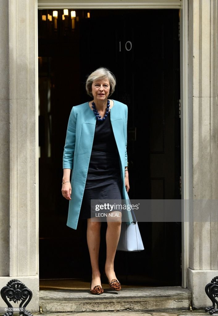 British Home Secretary Theresa May walks through the door of 10 Downing Street after attending a cabinet meeting in central London on June 27, 2016. European stock markets mostly slid Monday as British finance minister George Osborne attempted to calm jitters after last week's shock Brexit referendum. Britain's surprise referendum decision to leave the European Union wiped $2.1 trillion off market valuations on Friday and sent the pound collapsing to a 31-year low against the dollar. / AFP / LEON