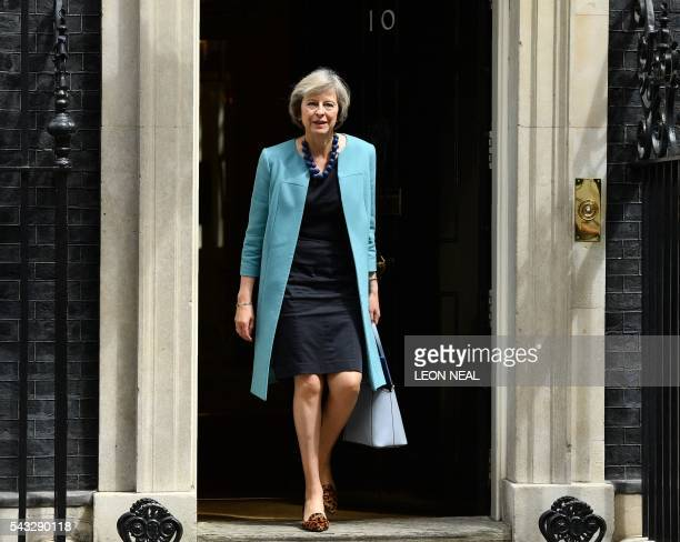 British Home Secretary Theresa May walks through the door of 10 Downing Street after attending a cabinet meeting in central London on June 27 2016...