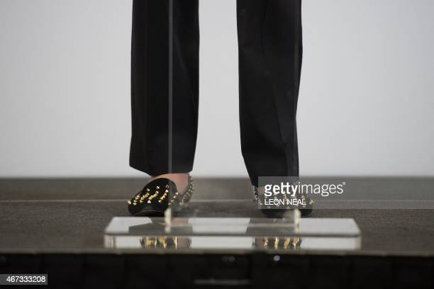 British Home Secretary Theresa May's shoes are pictured as she delivers a speech in central London on March 23 outlining the Conservative Party's...