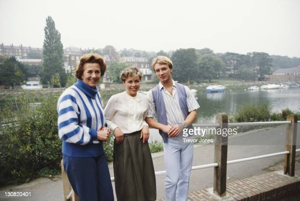 British ice dancers Jayne Torvill and Christopher Dean with their coach Betty Callaway stand along the River Thames on 1st June 1983 in Richmond...