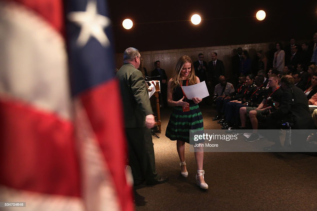 British immigrant Chevaun Tarrach carries away her certificate of U.S. citizenship during a naturalization ceremony on Ellis Island on May 27, 2016 in New York City. U.S. Secretary of Homeland Security Jeh Johnson administered the oath of citizenship to immigrants from 39 countries on the historic island in New York Harbor where millions of immigrants first arrived to America. The ceremony, held by U.S. Citizenship and Immigration Services (USCIS), was held in honor of Memorial Day and is one of 100 naturalization ceremonies held in U.S. national parks in celebration of the National Park Service's 100th anniversary.