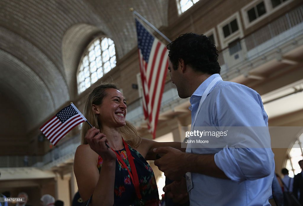 British immigrant Chevaun Tarrach (L), celebrates her new U.S. citizenship following a naturalization ceremony on Ellis Island on May 27, 2016 in New York City. U.S. Secretary of Homeland Security Jeh Johnson administered the oath of citizenship to immigrants from 39 countries on the historic island in New York Harbor where millions of immigrants first arrived to America. The ceremony, held by U.S. Citizenship and Immigration Services (USCIS), was held in honor of Memorial Day and is one of 100 naturalization ceremonies held in U.S. national parks in celebration of the National Park Service's 100th anniversary.