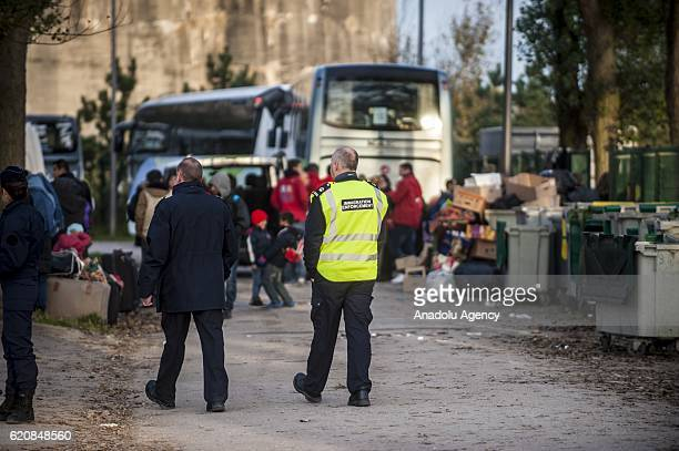 British immigration police enforcemement frames the refugees in Calais on November 3 2016 Over 350 women and Their children still living at the...