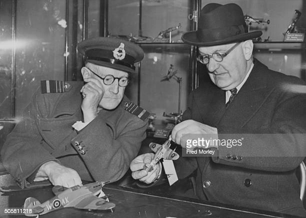 British industrialist Sir Frederick Handley Page and Air chief Marshal Sir William Mitchell Commandant of the ATC for London judging some models of...