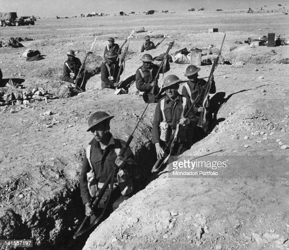 British infantry soldiers armed with bayonets standing in the trenches abandoned by the Italian troops at Sidi OmaráSidi Omar 6th June 1941