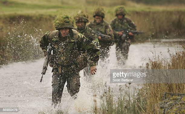 British infantry soldiers in action during a firepower demonstration at the Infantry Battle School on October 18 2005 in Brecon Wales A series of...