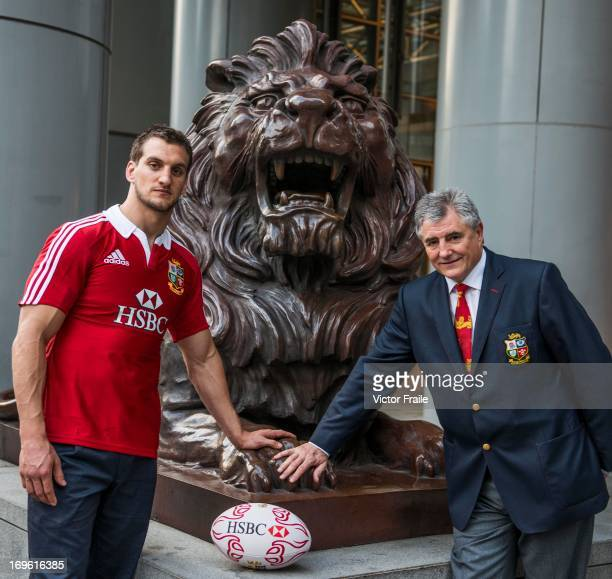 British Irish Lions captain Sam Warburton and Team Manager Andy Irvine rub the lion's paw for good luck at HSBC's head office in Hong Kong ahead of...