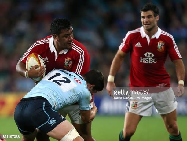 British Irish Lions' Mako Vunipola gets tackled by NSW Waratahs' Tom Carter