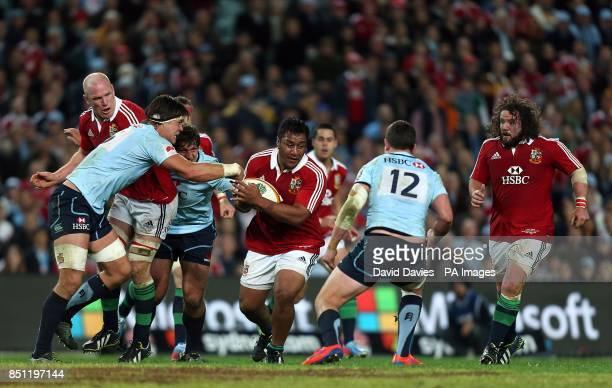 British Irish Lions' Mako Vunipola tries to break through the NSW Waratahs' defence