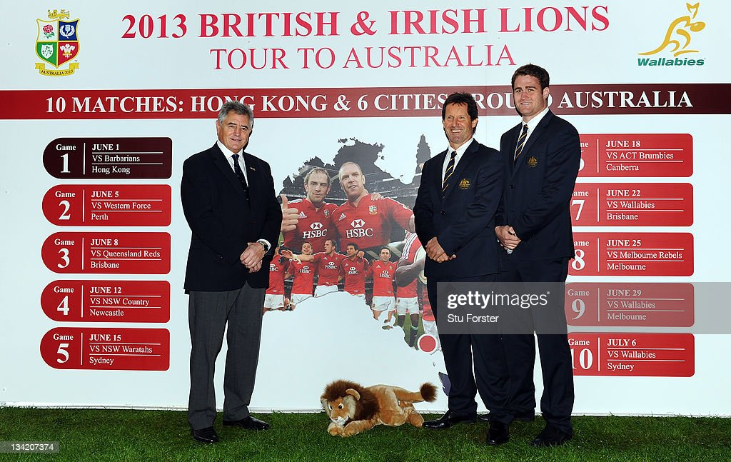 British & Irish Lions manager Andy Irvine, Wallabies head coach <a gi-track='captionPersonalityLinkClicked' href=/galleries/search?phrase=Robbie+Deans&family=editorial&specificpeople=606884 ng-click='$event.stopPropagation()'>Robbie Deans</a> and captain <a gi-track='captionPersonalityLinkClicked' href=/galleries/search?phrase=James+Horwill&family=editorial&specificpeople=637477 ng-click='$event.stopPropagation()'>James Horwill</a> pose beside the fixtures during the announcement of the 10-match schedule for the 2013 tour to Australia at Millennium Stadium on November 28, 2011 in Cardiff, Wales.