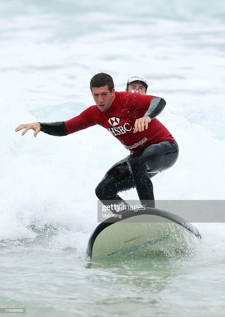 British Irish Lions player Justin Tipuric takes part surfing lessons on Bondi Beach on June 15 2013 in Sydney Australia