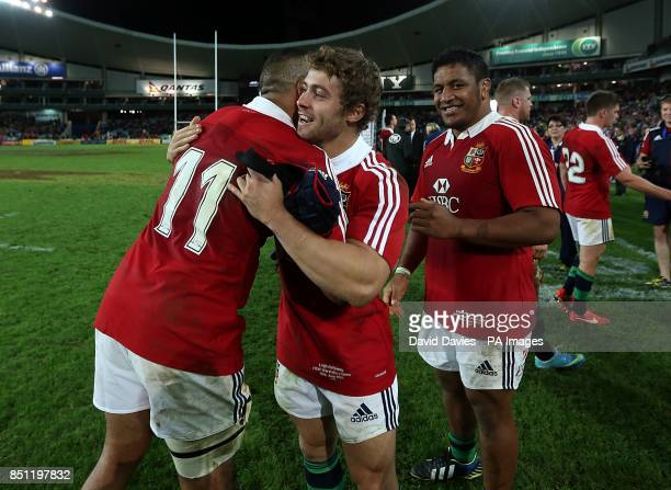 British Irish Lions' Simon Zebo Leigh Halfpenny and Mako Vunipola celebrate the win after the game