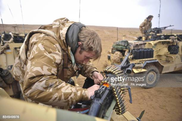 British Jackal top gunner James Sudlow from Owestry St Martins from 1st The Queens Dragoon Guards cleans and maintains a General Purpose Machine Gun...